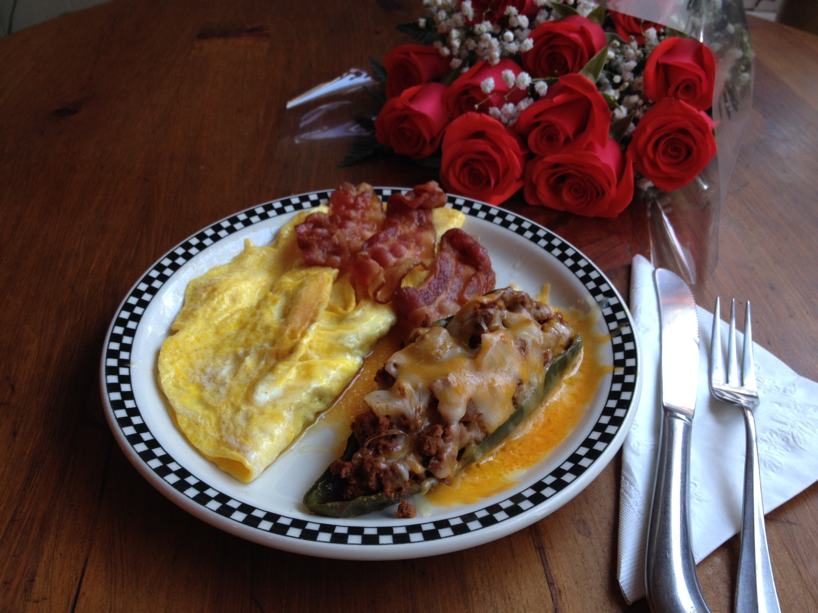 My reward for a good showing, Stuffed Poblano Chili Pepper, Bacon and a Cheese Omelet, and my second bulletproof coffee. Suzanne will get the Roses when he gets home.